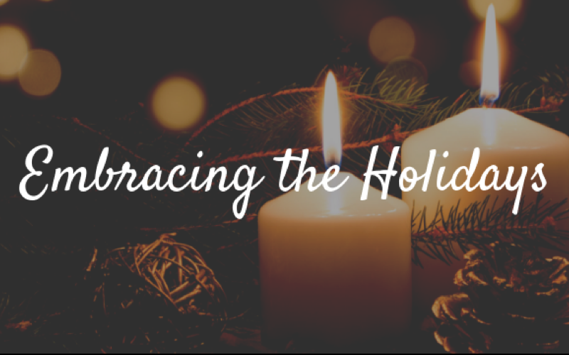Embracing the Holidays text over candles